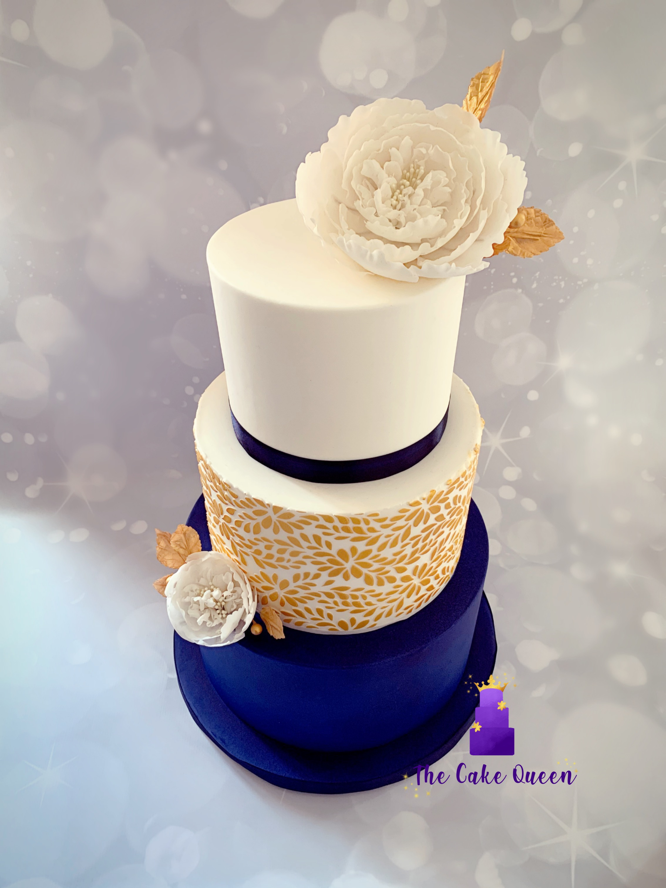 Navy blue and gold wedding cake. Lincoln UK.