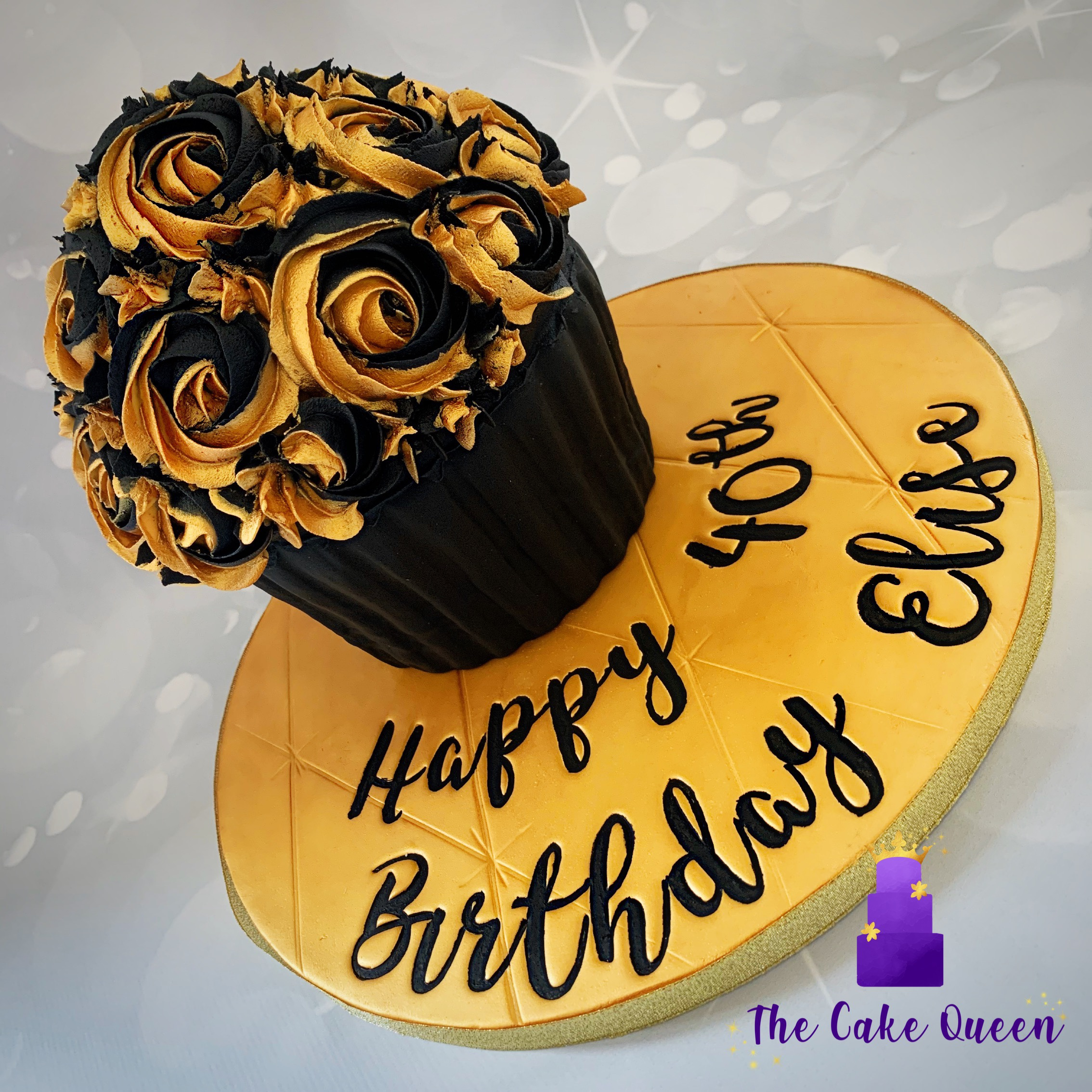 Black and gold giant cupcake.